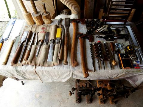 Timber framing tool table. Photo: smallape on Flickr, shared under Attribution-NonCommercial-ShareAlike 2.0 license.