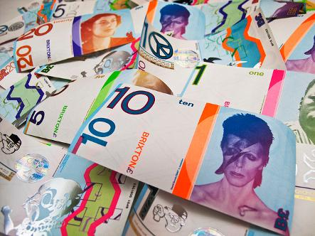 Finance and economics - a pile of the Brixton Pound, featuring David Bowie