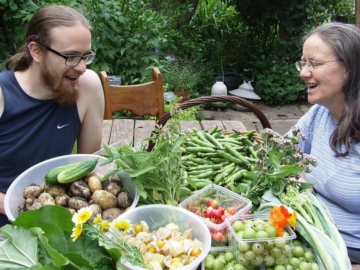 Sandy James and Nancy Bell with some of the harvest from their forest garden in 2014